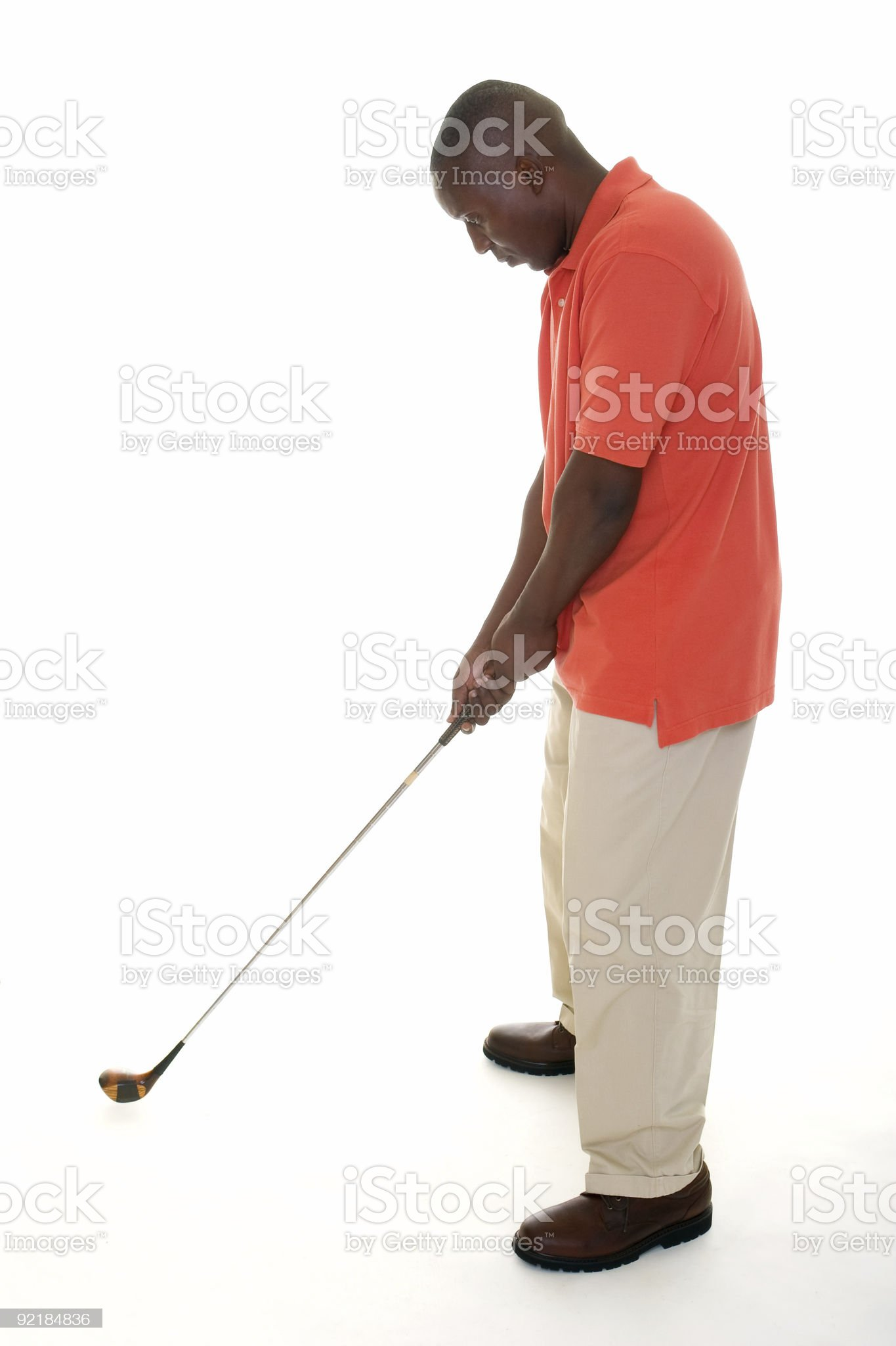 African American Man Swinging Golf Club royalty-free stock photo