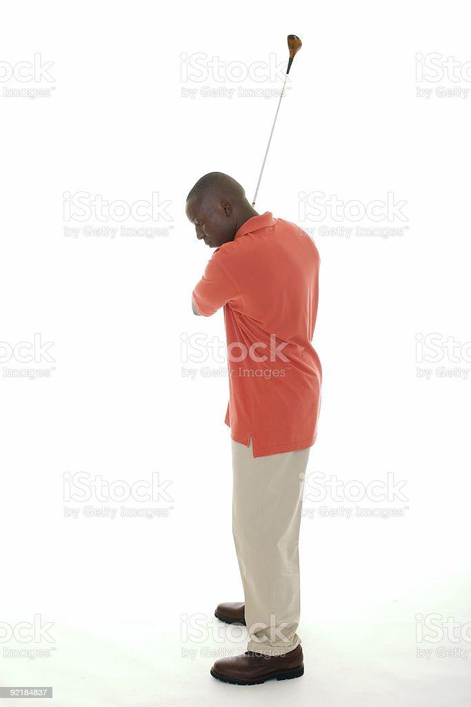 African American Man Swinging Golf Club royalty-free stock photo