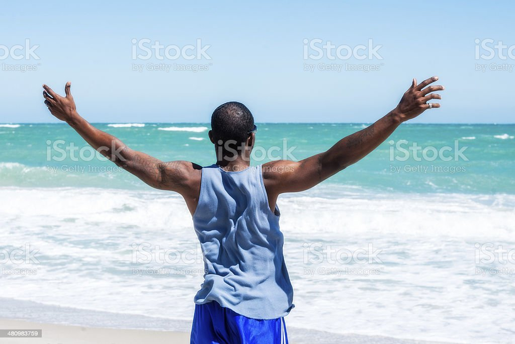 African American Man with Arms Open at Vero Beach stock photo