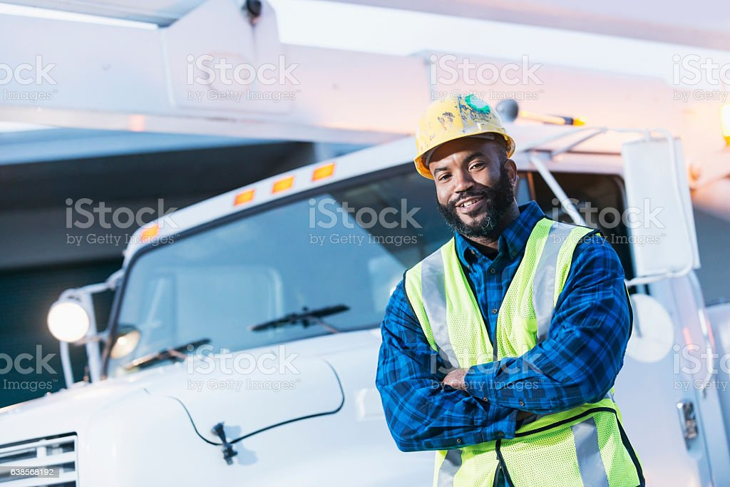 African American man with cherry picker truck stock photo