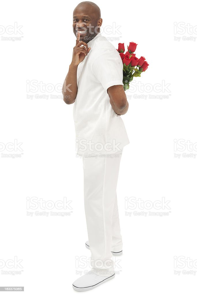 African American Man with Flowers Behind His Back royalty-free stock photo