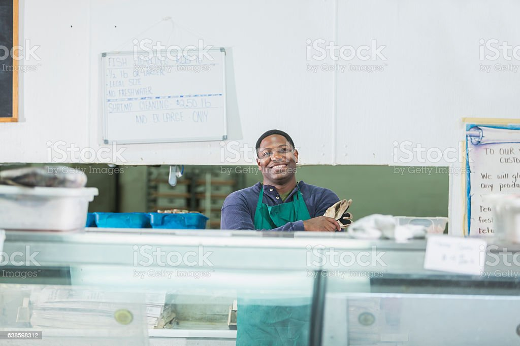 African American man working in fish market stock photo