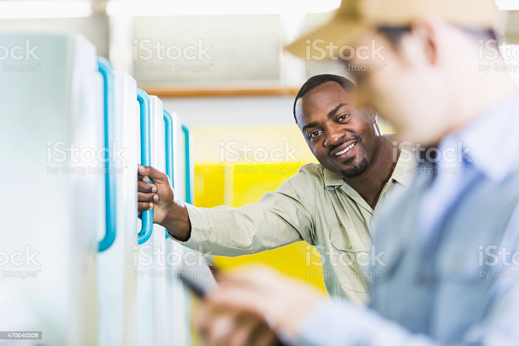 African American man working in printing plant stock photo