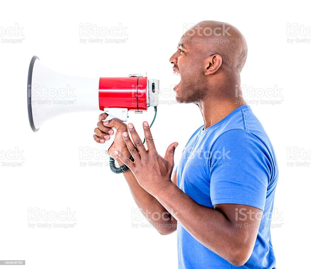African American man yelling through a loudspeaker stock photo