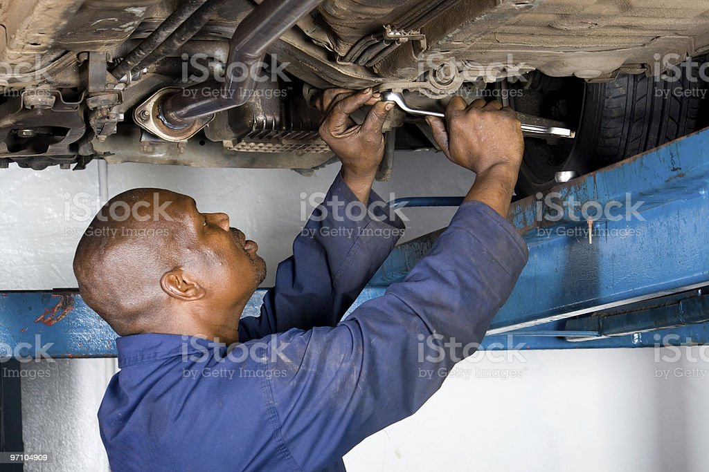 african american mechanic working on a vehicle royalty-free stock photo