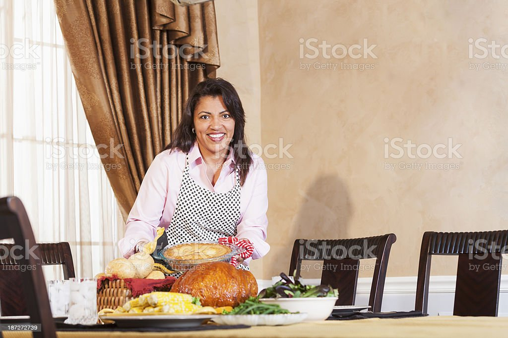 African American middle aged woman serving traditional holiday meal stock photo