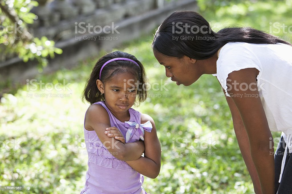 African American mother disciplining daughter stock photo