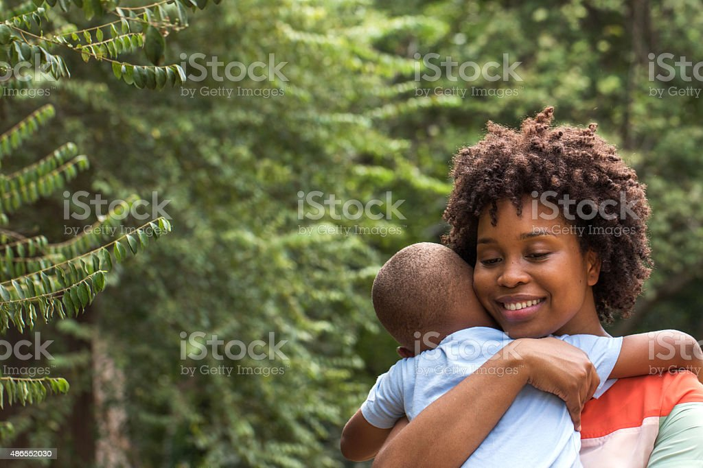 African American mother holding her son. stock photo