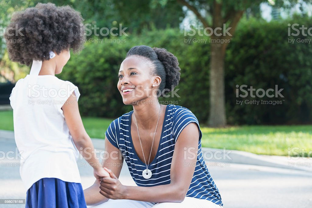 African American mother with mixed race little girl stock photo