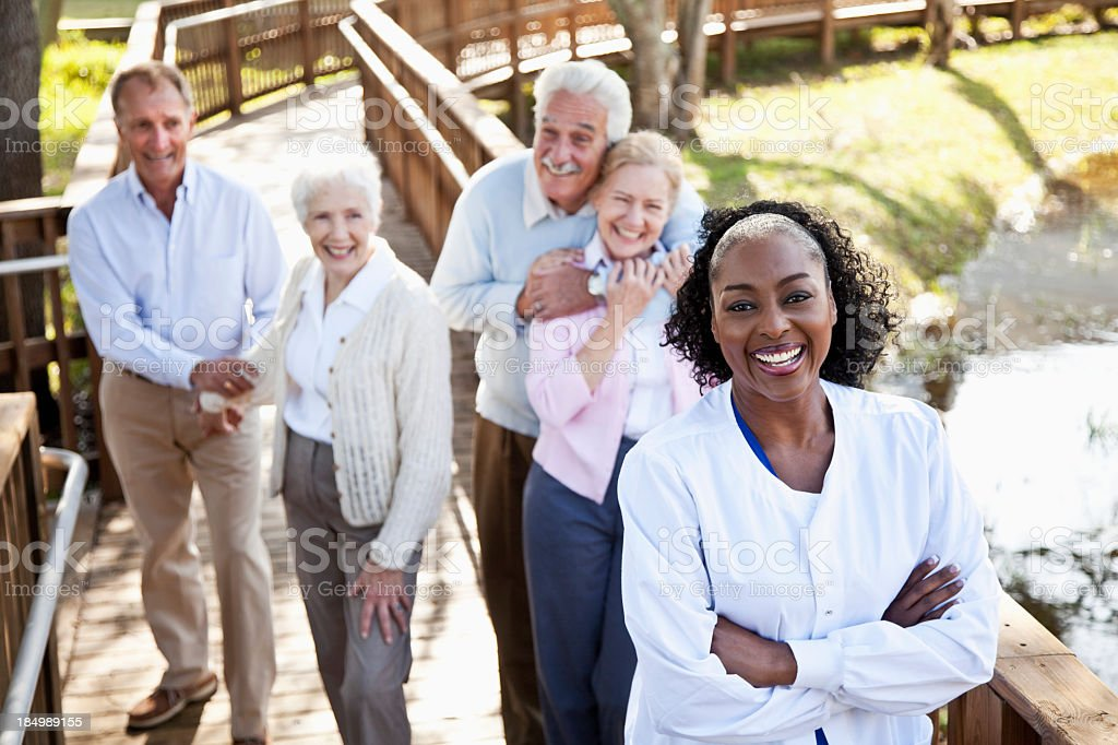 African American nurse at assisted living facility stock photo