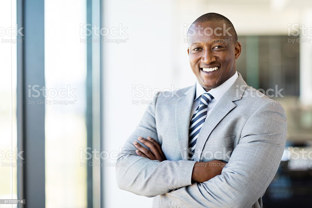 african american office worker with arms folded stock photo