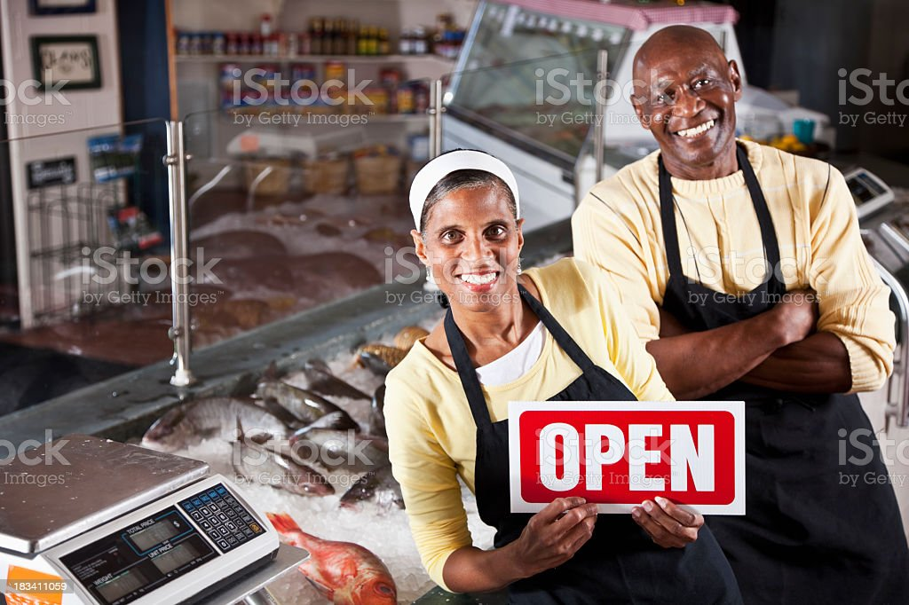 African American owners of fish market stock photo
