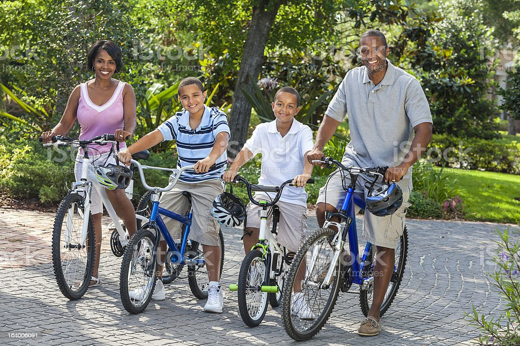 African American Parents Boy Children Riding Bikes royalty-free stock photo