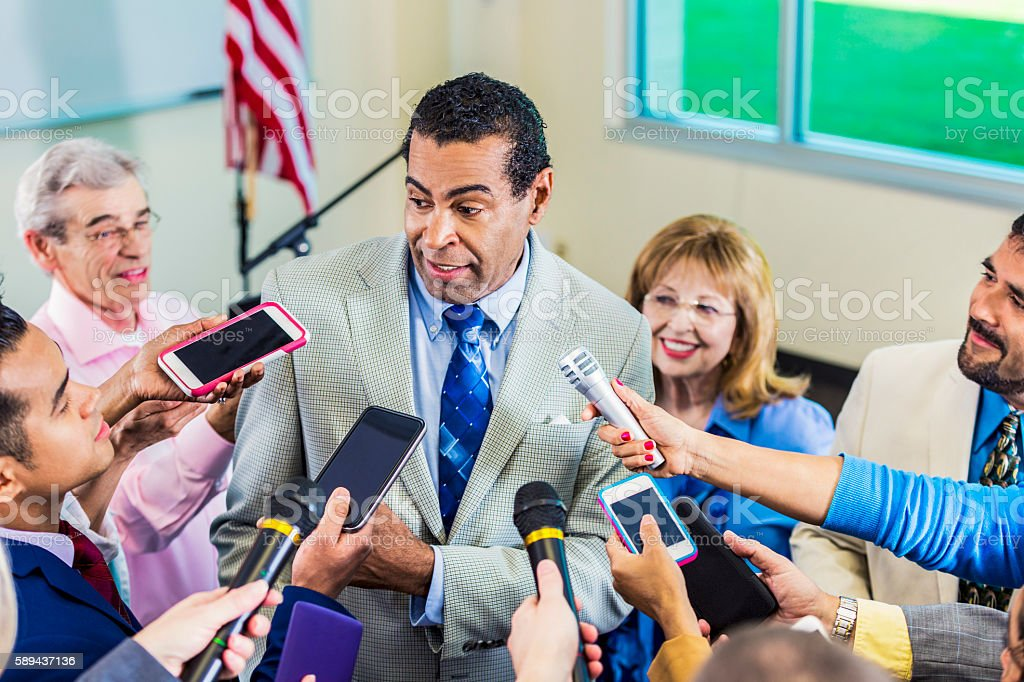 African american politician speaks to media stock photo
