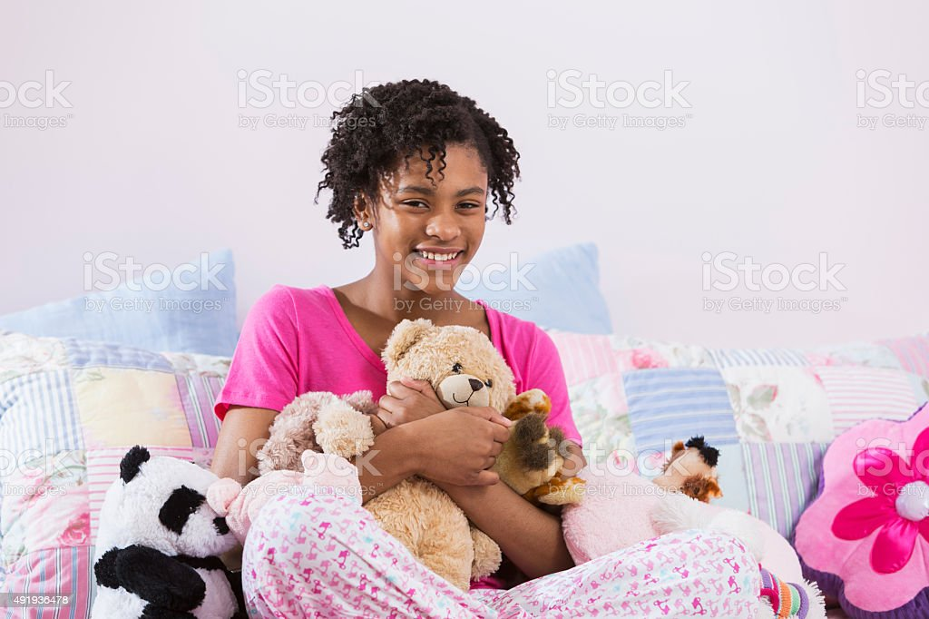 African American preteen girl in her bedroom stock photo