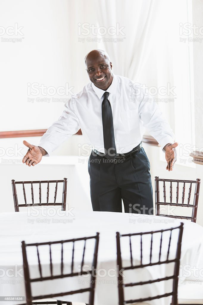 African American restaurant owner in dining room stock photo
