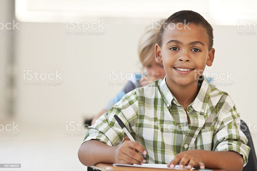 African American school boy making notes royalty-free stock photo