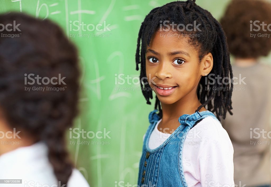 African American school girl in classroom stock photo