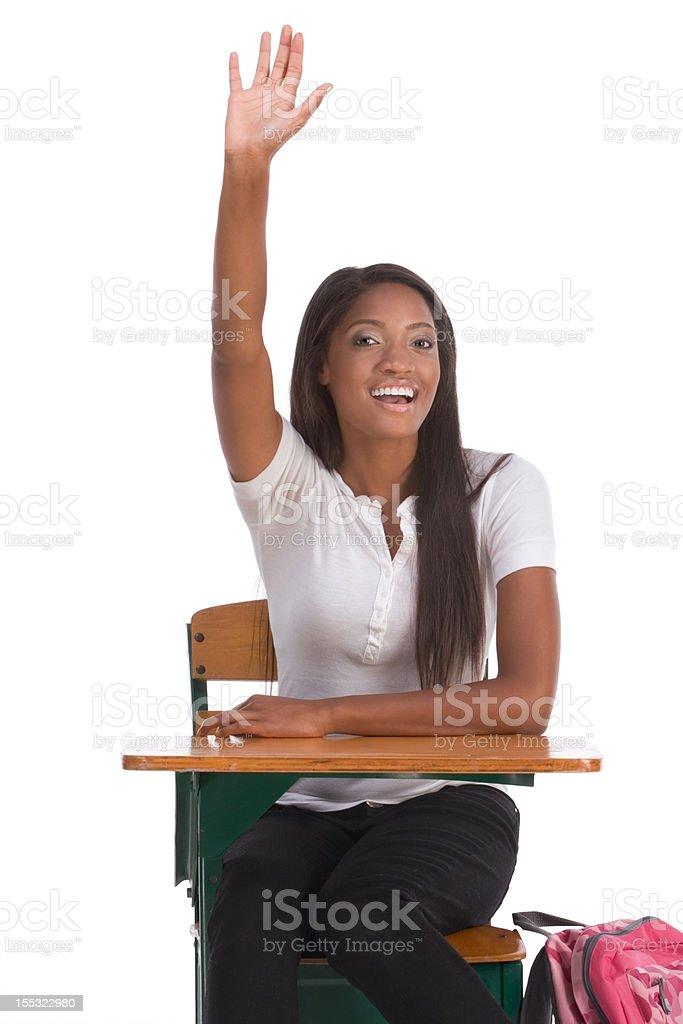 African American schoolgirl raised hand in class stock photo