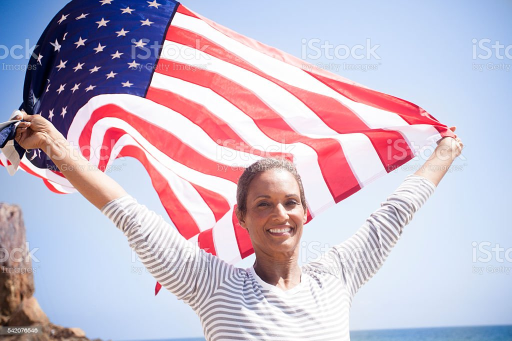 African American Senior Carrying USA Flag stock photo