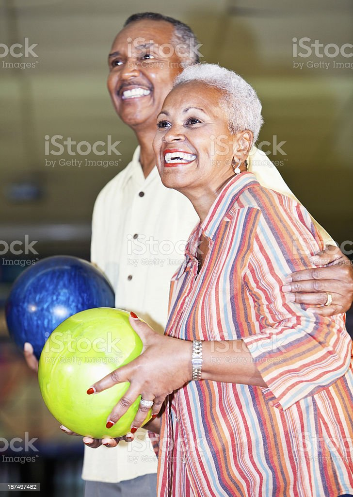 African American senior couple at bowling alley stock photo