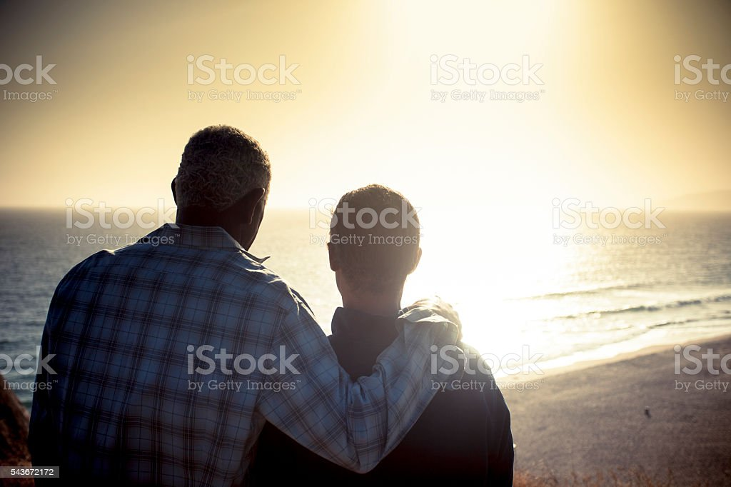 African American Senior Couple at Sunset on Beach stock photo
