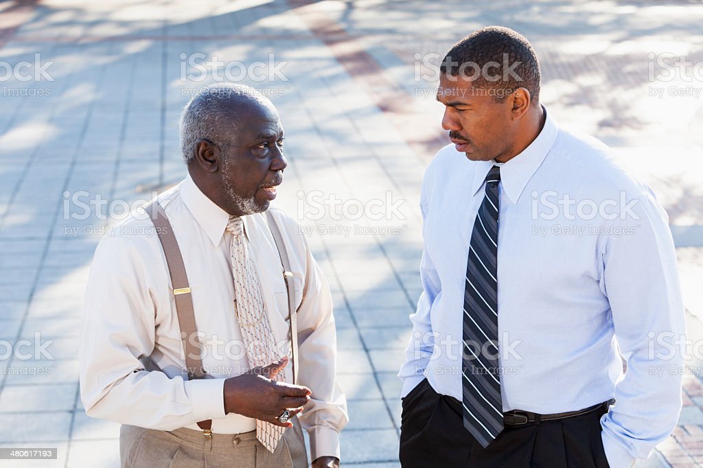 African American senior man with adult son stock photo