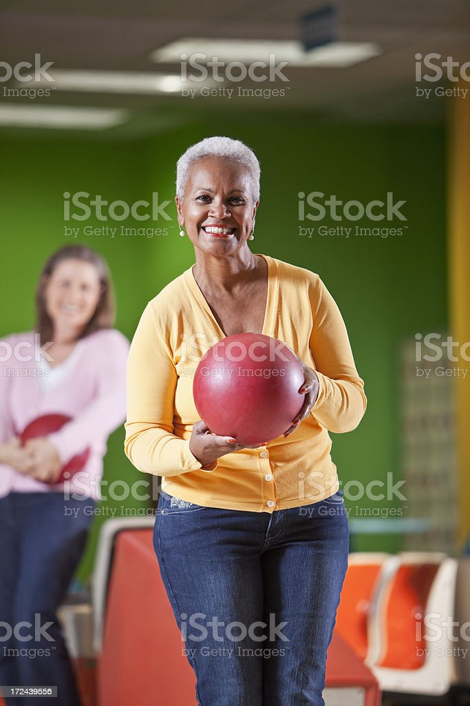 African American senior woman bowling stock photo