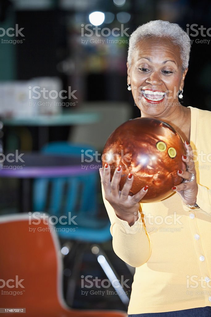 African American senior woman bowling stock photo