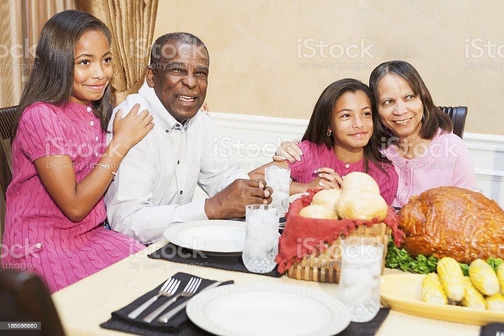 African American seniors with grandchildren enjoying holiday dinner stock photo
