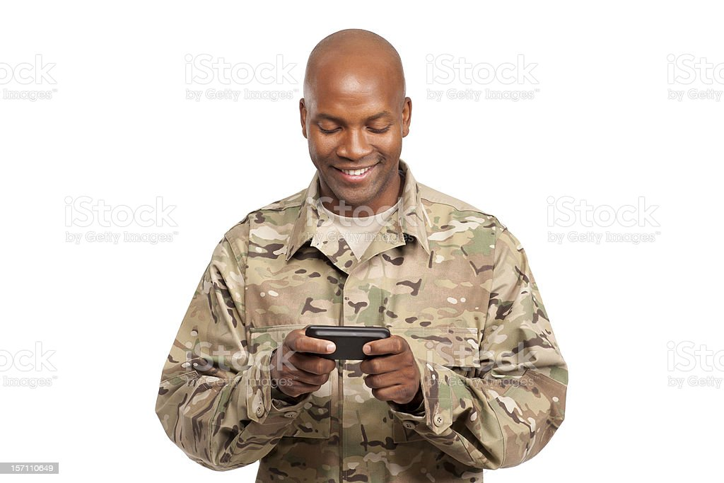 African american serviceman texting on cellphone royalty-free stock photo