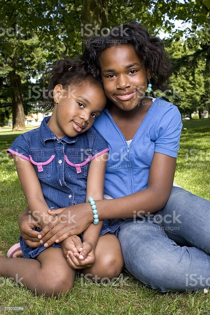 African American Sisters, Portrait of Girls in Sunny Park royalty-free stock photo