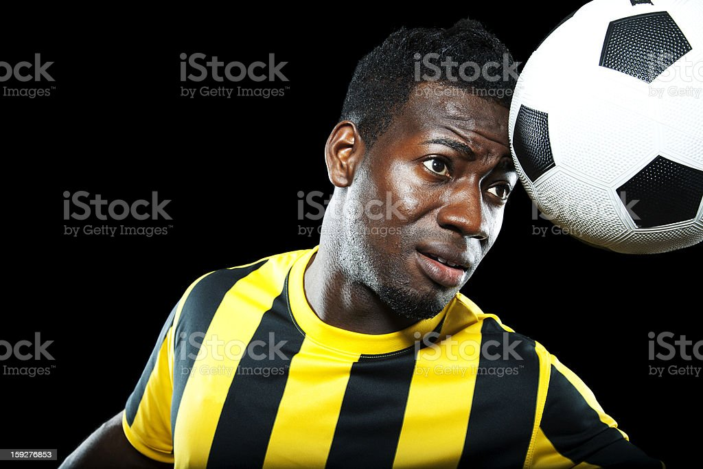 African American soccer player heading a football royalty-free stock photo
