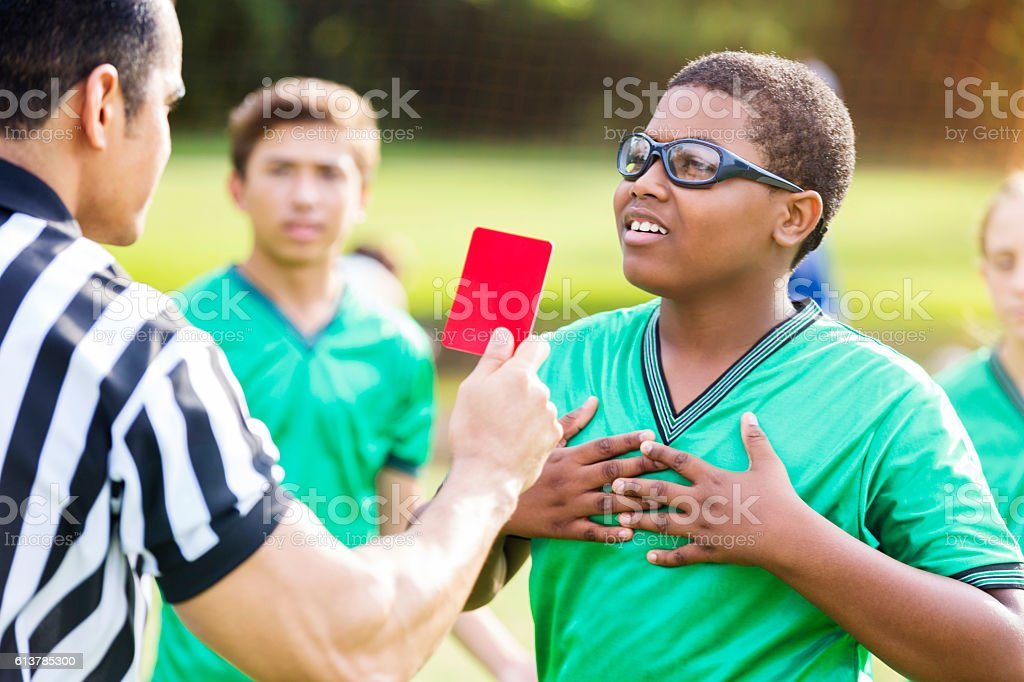 African American soccer player objects to referee's call stock photo