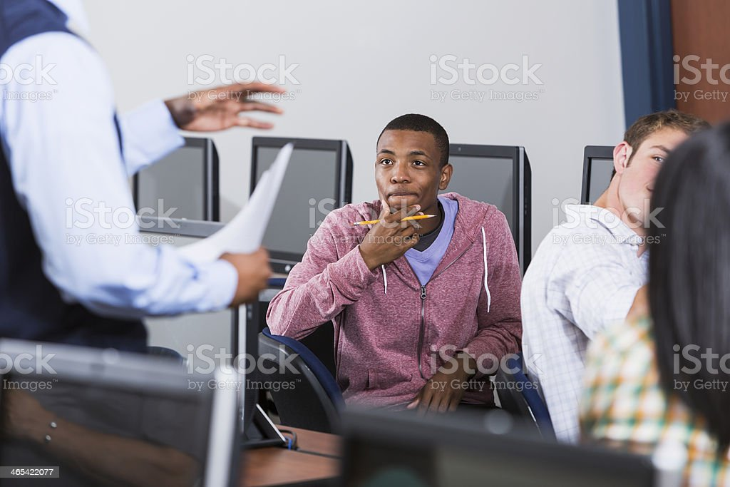 African American student in computer class watching instructor royalty-free stock photo