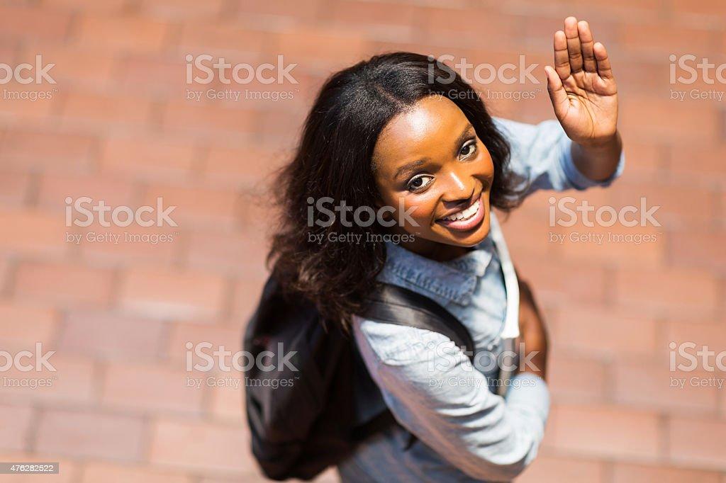 african american student waving goodbye stock photo