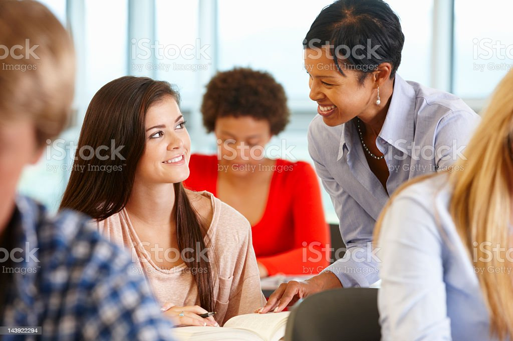 African American teacher helping student in class royalty-free stock photo