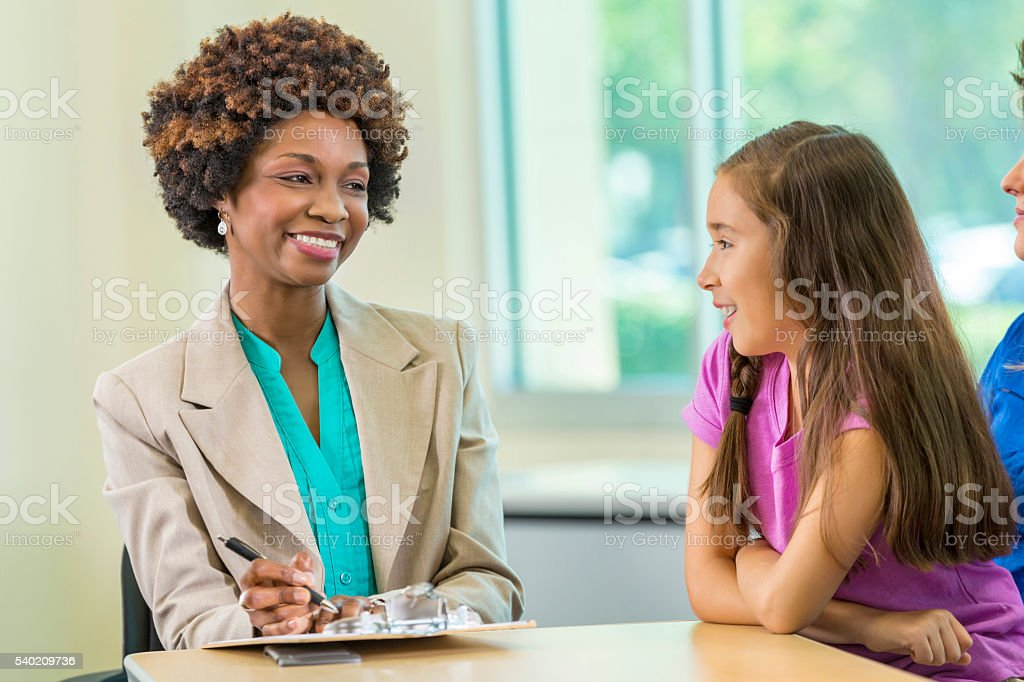 African American Teacher meets with student stock photo