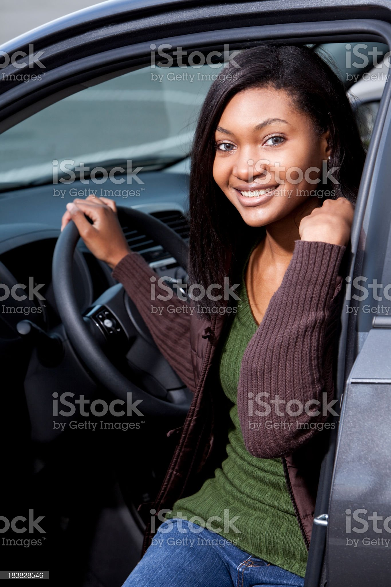 African American teen girl sitting in car royalty-free stock photo