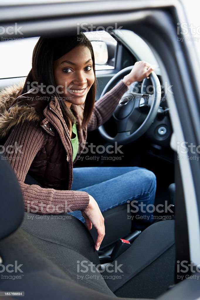 African American teenage girl driving car royalty-free stock photo