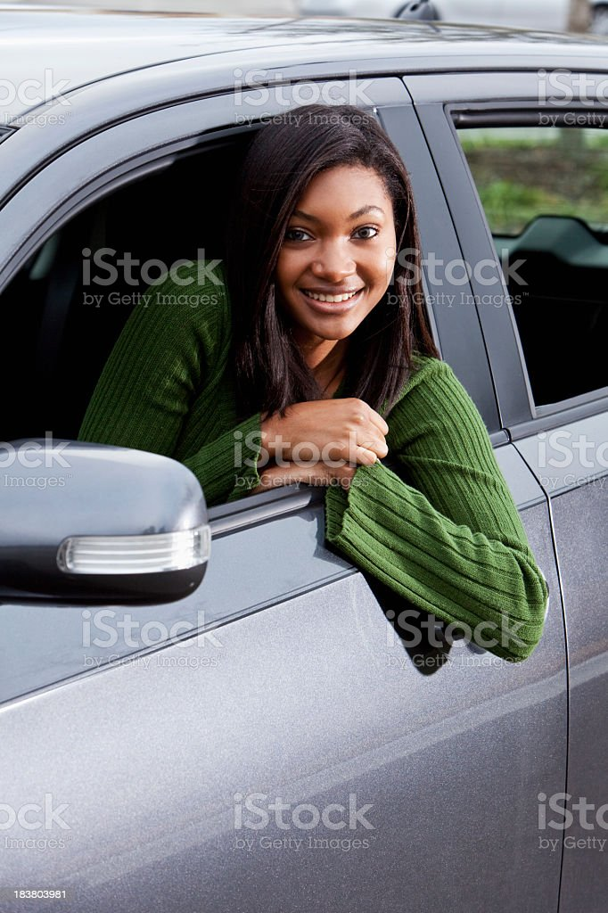 African American teenage girl driving car stock photo