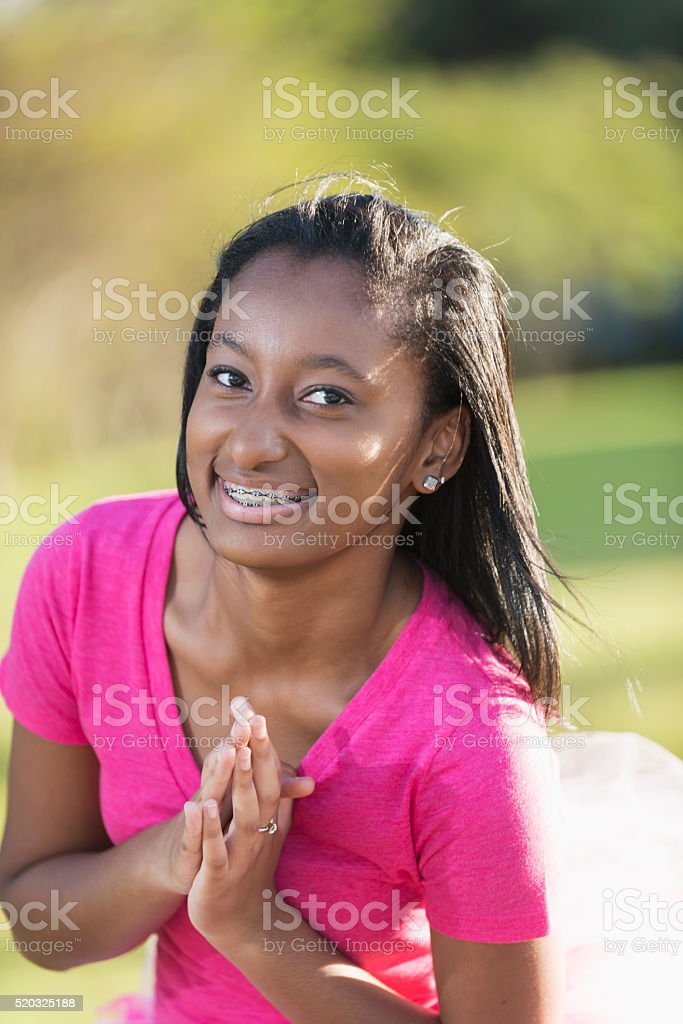 African American teenage girl wearing pink stock photo