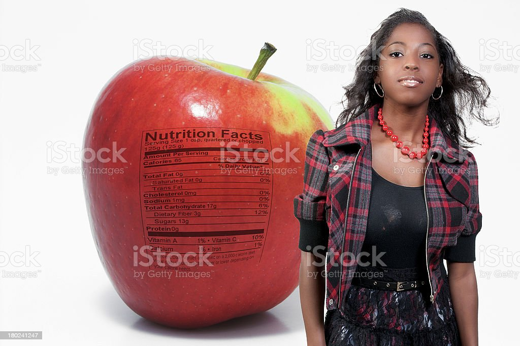 African American Teenager Apple Nutrition Facts royalty-free stock photo