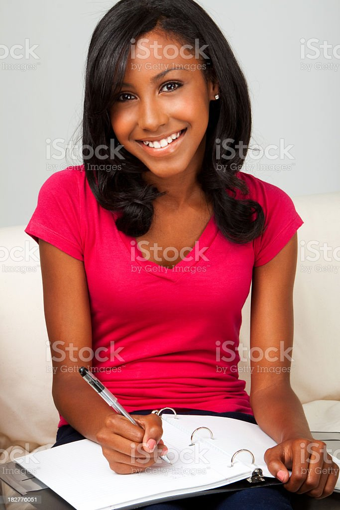 African American Teenager Doing Homework royalty-free stock photo