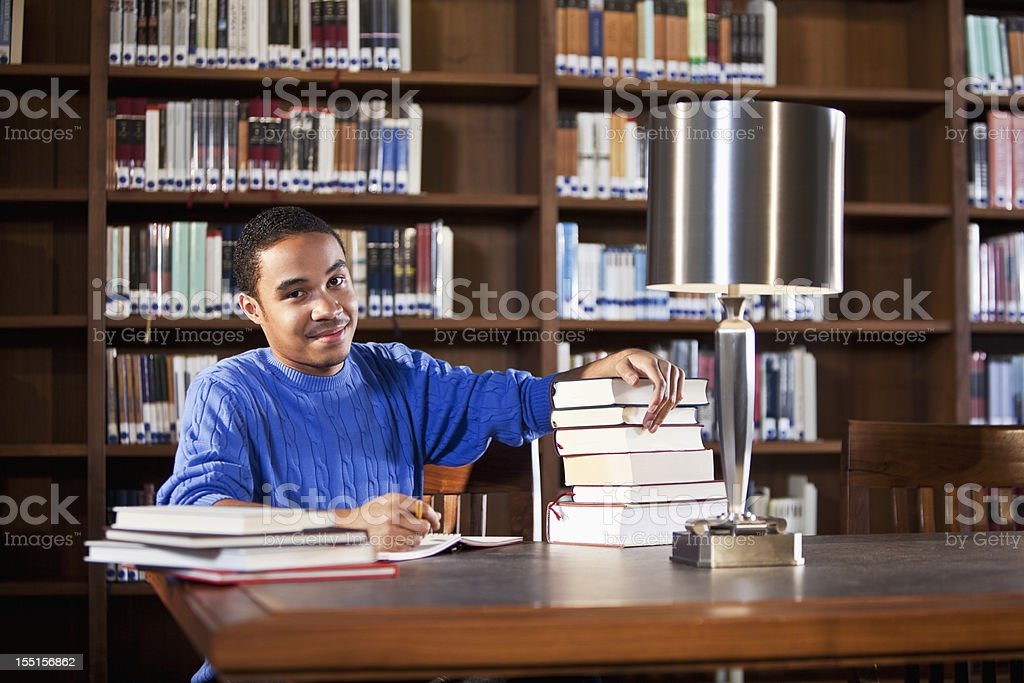 African American teenager studying in library royalty-free stock photo