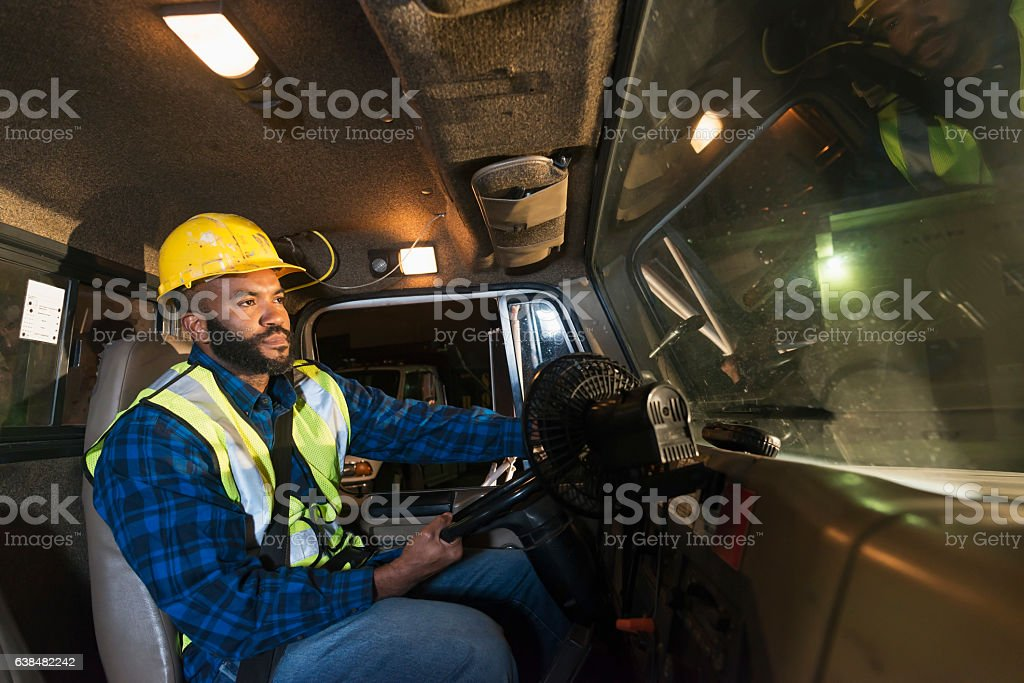 African American truck driver wearing hardhat stock photo
