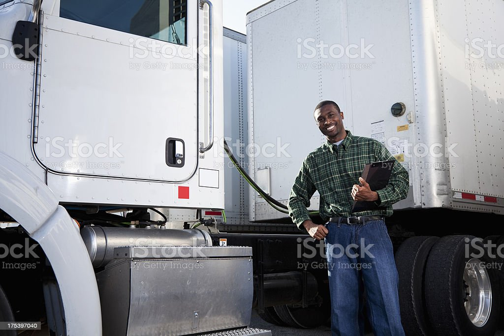 African American truck driver with clipboard stock photo