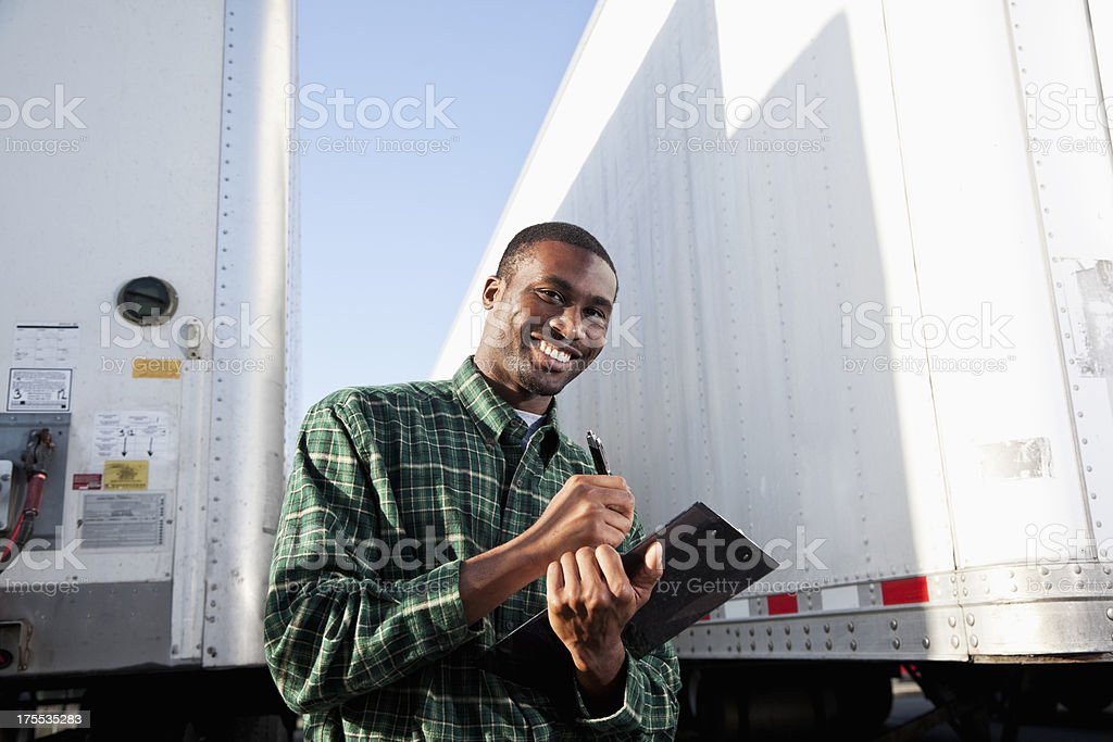 African American truck driver with clipboard royalty-free stock photo