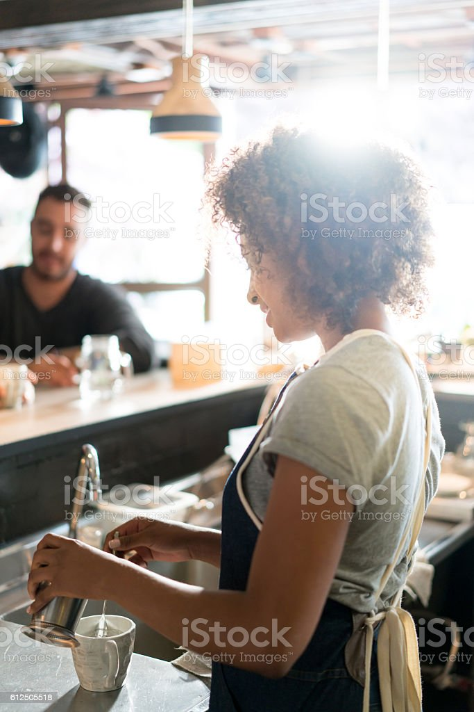 African American waitress serving at a restaurant stock photo