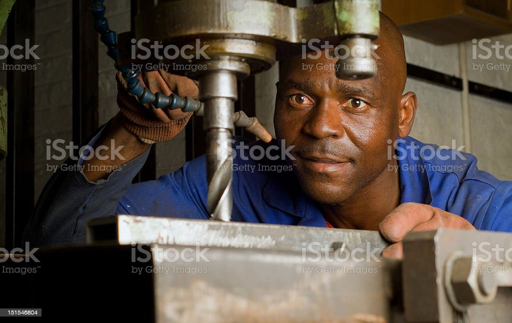African American with drill press stock photo